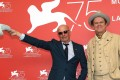 Director Jacques Audiard (left) and actor John C. Reilly at the Venice film festival. Photo: Claudio Onorati/ANSA via AP
