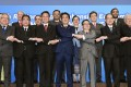 Japanese Prime Minister Shinzo Abe (front row, centre) joins hands with trade ministers from Asian countries during a Regional Comprehensive Economic Partnership meeting in Tokyo in July. Photo: AP