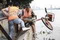 Bike sharing companies recently removed more than 3,000 bikes dumped in rivers in Guangzhou. Photo: thepaper.cn