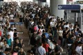 More than 3,000 people were left stranded at Kansai International Airport. Photo: EPA