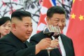 Kim Jong-un drinks a toast with Xi Jinping in Beijing in June. Despite the close ties between the two, Xi will not be travelling to North Korea for Sunday's 70th anniversary celebrations. Photo: AP