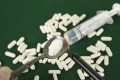 Crushed powdered opioids fentanyl in spoon with pills and a syringe. On Thursday, US law enforcement officials reaffirmed the Trump administration's contention that synthetic opioids produced in China are fuelling an opioid epidemic in the US. Photo: Shutterstock
