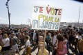 """A woman with a placard that reads """"I vote for the planet"""", during a demonstration for the climate, in Marseille, France, on Saturday. The march was part of a global day of protest ahead of a climate action summit later this month in San Francisco, California. Photo: AP"""