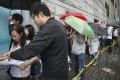 Nan Fung Development's LP6 project in Lohas Park attracted long queues of buyers at Octa Tower in Kowloon Bay, who braved a thunderstorm to snap up the units on offer on 8 September 2018. Photo: SCMP/Edward Wong.