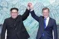 Kim Jong-un and Moon Jae-in at the truce village of Panmunjom in the demilitarised zone dividing the Korean peninsula. Photo: AP