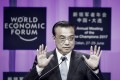Premier Li Keqiang speaks at last year's Summer Davos in Dalian. Li will address the Tianjin conference on Wednesday. Photo: Bloomberg
