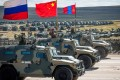 Russian, Chinese and Mongolian troops take part in a military equipment parade at Tsugol training ground in Siberia not far from the Chinese and Mongolian border on Thursday. Photo: AFP