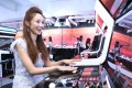 Elva Ni enjoying the arcade games at Chanel's Coco Game Center