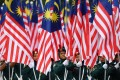 Malaysian school cadets carry national flags during the National Day celebration parade in Putrajaya, on the outskirts of Kuala Lumpur, on August 31. Malaysia celebrates its independence from British rule on that day, and the formation of the Federation of Malaysia on September 16. Photo: AFP