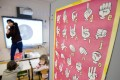 A teacher uses sign language to communicate with hearing-impaired pupils at a school in France. Picture: AFP