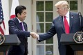 U.S. President Donald Trump, right, shakes hands with Shinzo Abe, Japan's prime minister, positioned himself not just as US President Donald Trump's man in Asia, but his closest ally among world leaders, writes William Pesek. Photo: Bloomberg