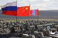 Russian, Chinese and Mongolian national flags fly from armoured vehicles during joint military exercises on Thursday in eastern Siberia. Photo: AP