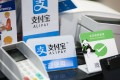 The Faster Payment System due to launch Monday will benefit online payments systems such as Alipay, PayMe and WeChat Pay, among others. Photo: Bloomberg