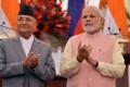 Prime Minister K.P. Sharma Oli (left) is seen with Indian Prime Minister Narendra Modi in April Photo: EPA-EFE