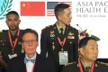 Front, left to right: Terry Rauch, acting US deputy assistant secretary of defence, and General Song Puxuan, head of China's Central Military Commission's Logistics Support Department, at the opening of the Asia-Pacific Military Health Exchange on Monday, September 17. Photo: Reuters