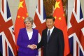 Chinese President Xi Jinping shakes hands with Britain's Prime Minister Theresa May ahead of their meeting at the Diaoyutai State Guesthouse in Beijing on February 1, 2018. Photo: AFP