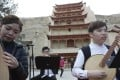 Musicians of the Gaudeamus Dunhuang Ensemble from Hong Kong rehearse before a performance in front of the Nine-Storey Pagoda at the Mogao Caves of music inspired by the ancient grottoes' Buddhist art and artefacts. Photo: Simon Song