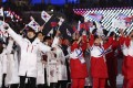 North and South Koreans wave flags during the closing ceremony of the 2018 Winter Olympics in Pyeongchang, South Korea. Photo: AP