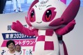 "Paralympic mascot ""Someity"" strikes a pose as Yuriko Koike, the Governor of Tokyo, looks on during a countdown event in Tokyo on August 25. Photo: AP"