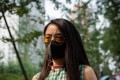 A woman wears a protective face mask to fight bad air pollution on a street in Beijing this summer. Photo: AFP