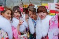 Young Japanese women take a wefie on Coming of Age Day. Female adults have a rough time in Japan. They are paid a third less than men for similar work. Photo: EPA