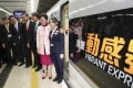Chief Executive Carrie Lam (second from right) poses with guests before setting off on the first cross-border train. Photo: Edward Wong