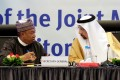 OPEC Secretary-General Mohammed Barkindo, left, with Saudi Arabian Energy Minister Khalid al-Falih during the inaugural session ceremony of the OPEC Ministerial Monitoring Committee in Algiers, Algeria, on Sunday. Photo: Reuters