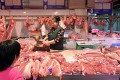 A butcher's stall at a Beijing market. A low-carb diet that relies too much on meat as a source of protein has been linked to a shorter lifespan. Photo: AFP