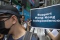 Pro-independence supporters gather near the Hong Kong Foreign Correspondents' Club on August 14 in support of National Party leader Andy Chan, who gave a speech at the venue. Photo: EPA