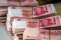 China maintains strict controls over capital flows, giving it leeway to keep interest rates low without risking capital flight. Photo: AFP