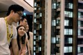 Prospective buyers assess a model of the LP6 property development by Nan Fung Group at a sales centre in Hong Kong. Photo: Reuters