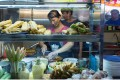 A vendor prepares food at a stall in the Old Airport Road Food Centre in Singapore. Photo: Bloomberg