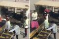 Airport staff throw passengers' luggage into a cart at Hong Kong airport. Photo: Facebook