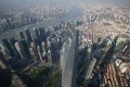 A general view from Shanghai Tower Observation Deck showing Shanghai World Financial Center. Photo: EPA