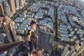 Chinese rooftopping star Wu Yongning posted nearly 300 videos showing his daredevil exploits on buildings across China until he fell to his death from a 52-floor building in Changsha. Photo: 163.com
