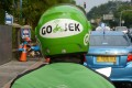 A motorcycle driver with Indonesian ride-hailing start-up Go-Jek waits for customers along a street in Jakarta. Photo: Agence France-Presse