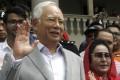Former Malaysian prime minister Najib Razak and his wife, Rosmah Mansor. Photo: AP