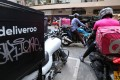 Deliveroo and Panda bikes going head-to-head in Wan Chai, Hong Kong. Photo: SCMP