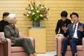 Japanese Prime Minister Shinzo Abe speaks with IMF managing director Christine Lagarde in Tokyo. Photo: EPA