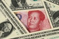 If China is unsure of earning enough US dollars to pay for its imports, it no longer makes sense for Beijing to manage the value of the yuan against the US dollar. Photo: Kyodo