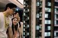 Prospective buyers look at a model of the LP6 development at a sales centre in Hong Kong. Photo: Reuters