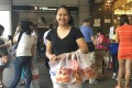Noemi Morgado, from the Philippines, is a Jollibee regular. She works as a foreign domestic helper in Hong Kong for a Singaporean couple with four children, and is shown heading home with chicken for everyone. Photo: Cheryl Arcibal