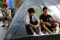 (Left to right) Hendrick Lui, Lam Wing-hang and Victor Yuen ended their hunger strike on Sunday. Photo: Edmond So