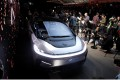 Journalists gather around a Faraday Future FF 91 electric car during an unveiling event at CES in Las Vegas, on January 3, 2017. Photo: Reuters