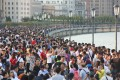 """Visitors throng the Bund, Shanghai's iconic waterfront, on the second day of this year's National Day """"Golden Week"""" holiday in China but consumer spending was slow compared to last year. Photo: Reuters"""