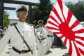 Japanese navy veterans march at the Yasukuni Shrine. Photo: Reuters