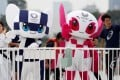 Tokyo 2020 Olympic Games mascot Miraitowa and Paralympic mascot Someity wave with Japan's Paralympic long-jumper Hajimu Ashida and karateka Kiyo Shimkizu in Tokyo in July. Photo: Reuters