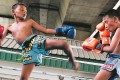 Twin brothers Jirasak and Pornsak Katsriphuak, who are 10 years old, duke it out during a Muay Thai training session. Photo: Tibor Krausz
