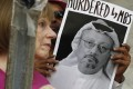 People hold signs during a protest at the embassy of Saudi Arabia about the disappearance of Saudi journalist Jamal Khashoggi. Photo: AP Photo
