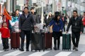 Tourists in the Ginza shopping area of Japan. Photo: AFP